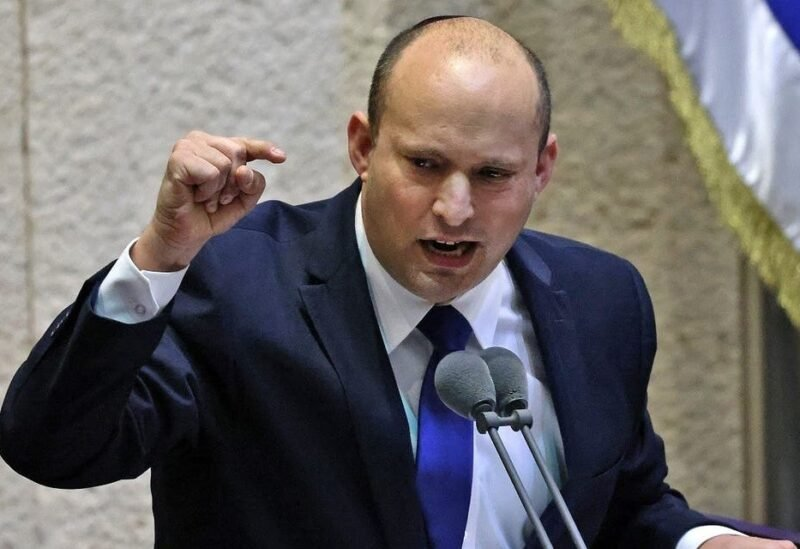 Naftali Bennett addresses lawmakers during a special session to vote on a new government at the Knesset in Jerusalem, on June 13, 2021. (File photo: AFP)