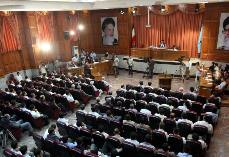 A general view of a courtroom shows suspected opposition supporters (in grey) attending a session in their trial at the revolutionary court in Tehran on August 25, 2009. (AFP)