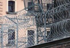 File photo of the outside of a prison. (Unsplash, Pawel Czerwinski)