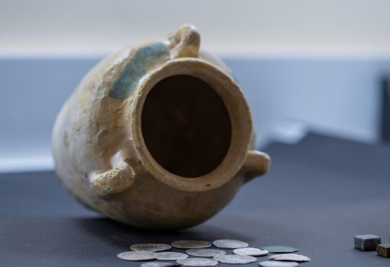 A local team from the Sharjah Archaeology Authority has discovered several old Islamic coins in the central region of Sharjah, consisting of rare silver dirhams dating back to the Abbasid Dynasty. (Supplied: WAM)