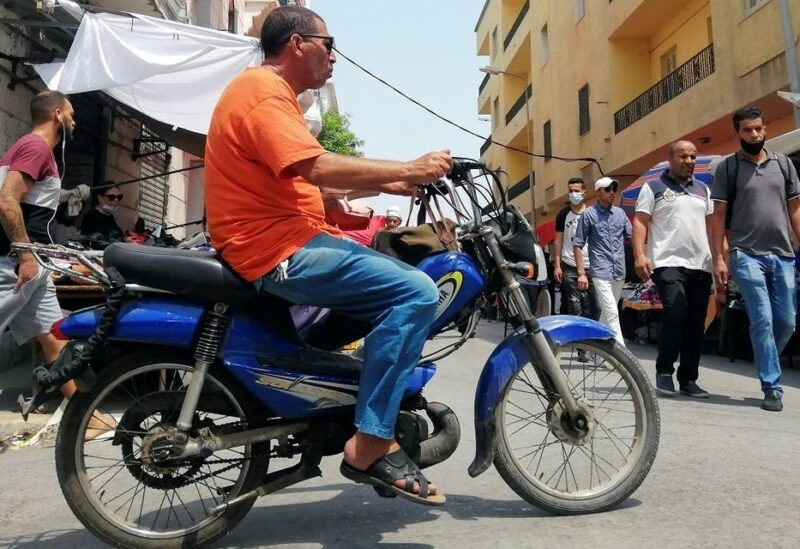 A man rides a motorbike in Tunis, Tunisia, on August 12, 2021. (Reuters)