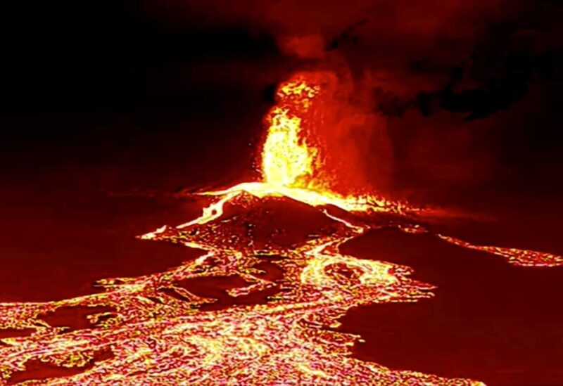 Screen grab from a video taken by a night drone shows a volcano erupting and tongues of lava in La Palma, Spain September 22, 2021. (Reuters)
