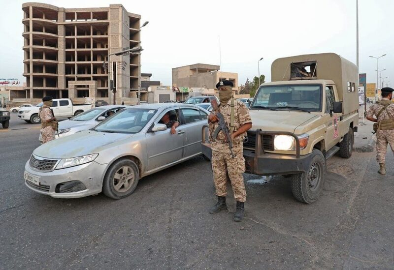 Libyan soldiers man a checkpoint southeast of the capital Tripoli, on September 4, 2021, after clashes near the Tekbali barracks, the headquarters of 444 Brigade. (Mahmud Turkia/AFP)