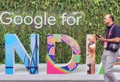 """A man walks past the sign of """"Google for India,"""" the company's annual technology event in New Delhi, India. (Reuters)"""