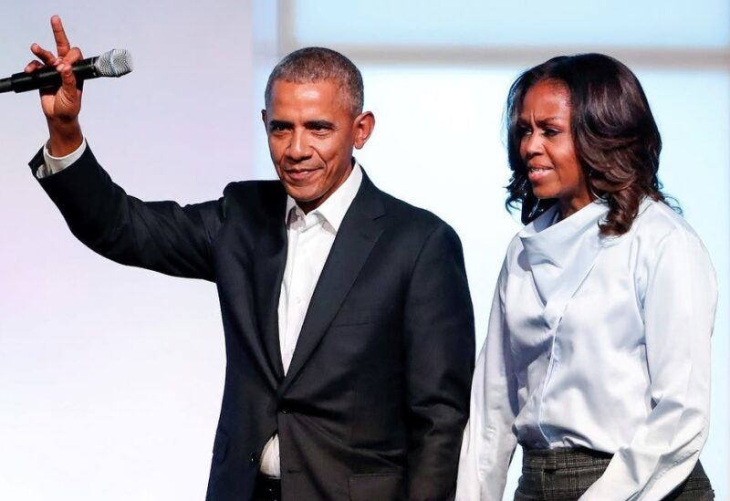 Former US President Barack Obama and former first lady Michelle Obama greet guests during the first day of the Obama Foundation Summit in Chicago, Illinois, US, on October 31, 2017. (Reuters)