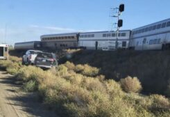 In this photo provided by Kimberly Fossen an ambulance is parked at the scene of an Amtrak train derailment on Saturday, Sept. 25, 2021, in north-central Montana. Multiple people were injured when the train that runs between Seattle and Chicago derailed Saturday, the train agency said. (AP)
