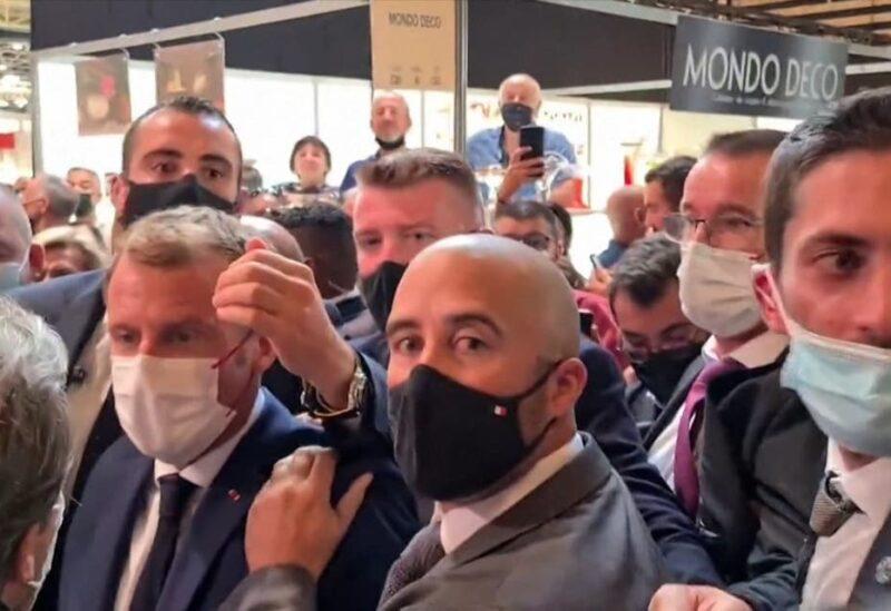 Macron egged by protester shouting 'Vive la Revolution'. (Screengrab)