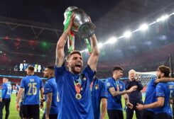 Italy's Domenico Berardi celebrates with the trophy after winning Euro 2020 with teammates. (Reuters)