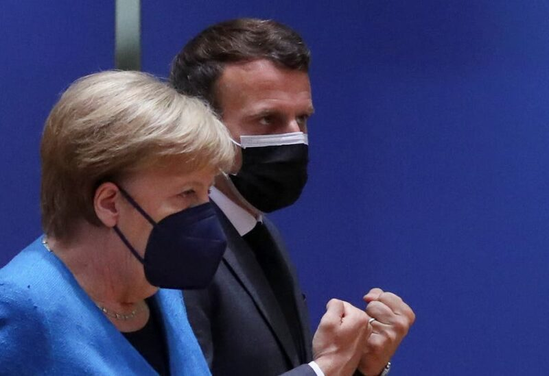 French President Emmanuel Macron and German Chancellor Angela Merkel attend a face-to-face EU summit in Brussels, Belgium, on May 24, 2021. (Reuters)