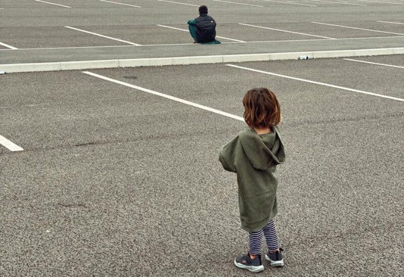 Afghan refugee children in a hotel carpark in London