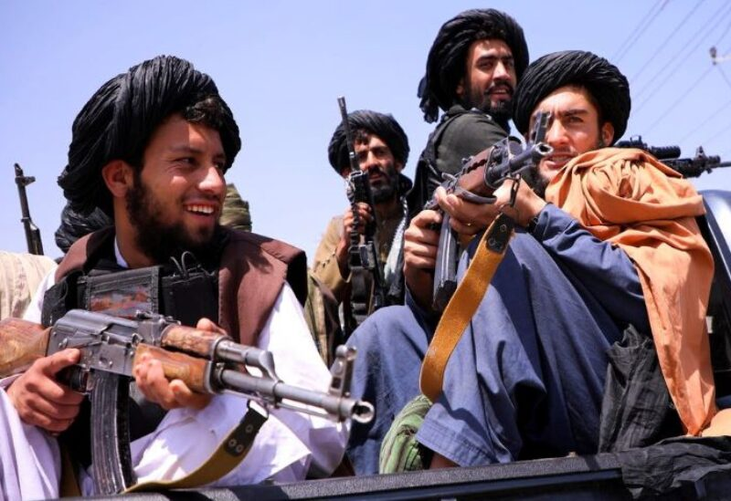 Taliban forces patrol in front of Hamid Karzai International Airport in Kabul, Afghanistan