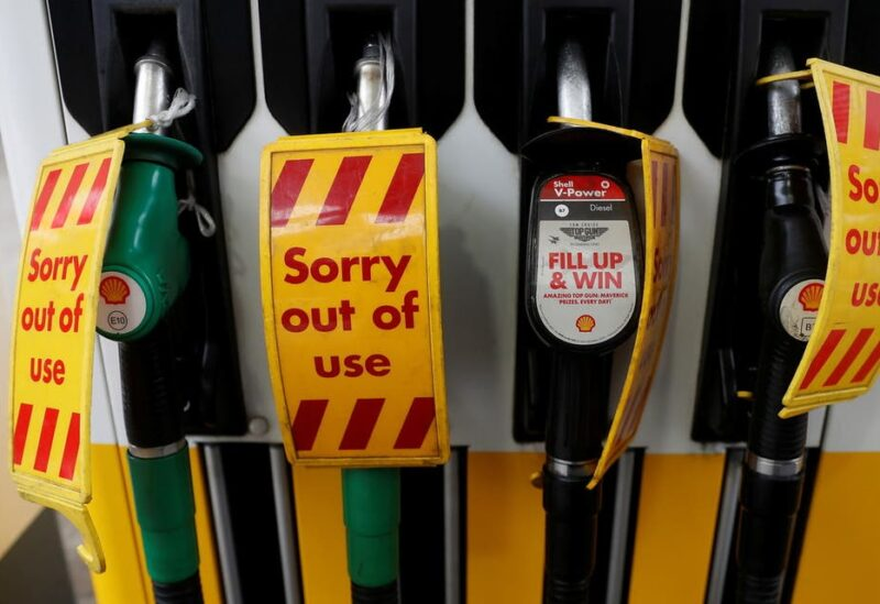 Out of use signs are seen on fuel pumps at a filling station that has run out of fuel, in London, Britain, September 25, 2021. (Reuters)