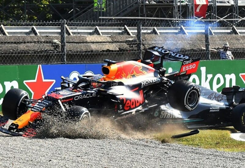 Red Bull's Max Verstappen and Mercedes' Lewis Hamilton crash out of the race. (Reuters)