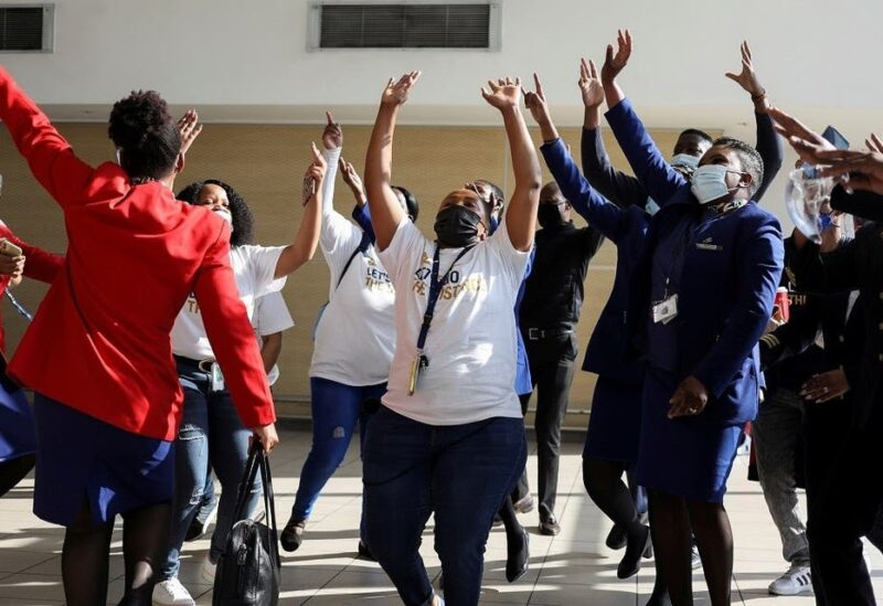 Workers sing and dance as a South African Airways (SAA) airplane prepares to take off after a year-long hiatus triggered by the national airline running out of funds, at O.R. Tambo International Airport in Johannesburg, South Africa, on September 23, 2021. (Reuters)