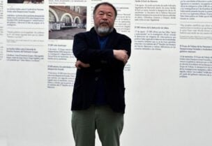 Chinese contemporary artist and activist Ai Weiwei poses in front of his new exhibition at the University Museum of Contemporary Art (MUAC) in Mexico City on April 11, 2019. (AFP)