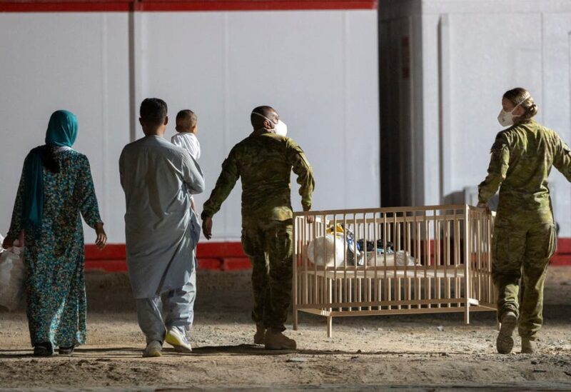 A handout photo taken on August 21 and received on August 22, 2021 from the Australian Defence Force shows people being escorted to their quarters following their evacuation flight from Afghanistan, at the Al Minhad Air Base some 25 kilometres south of Dubai. (File photo: AFP)