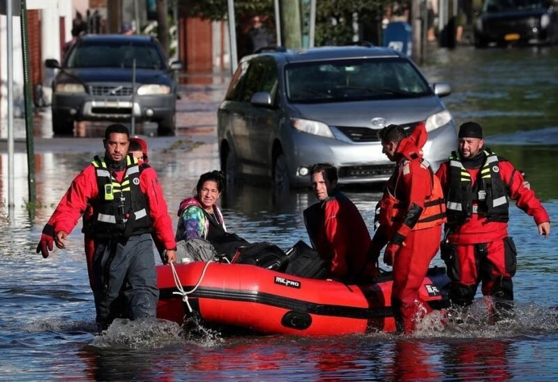First responders pull local residents trapped by floodwaters after the remnants of Tropical Storm Ida in Mamaroneck, New York, Sept. 2, 2021. (File photo: Reuters)